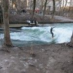Watching surfers on the Isar River in Munich