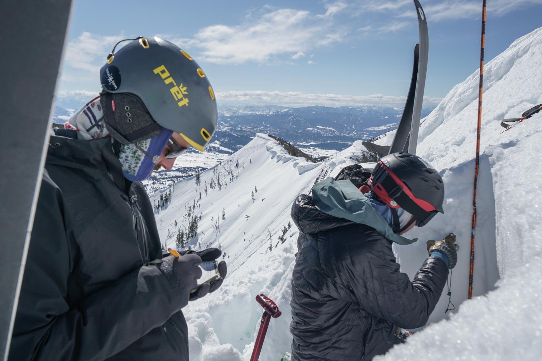 Andrew recording Alex's data in snowpit